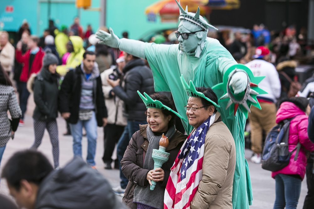 People in Times Square in Manahttan, New York, on Dec. 25, 2014. (Samira Bouaou/Epoch Times)