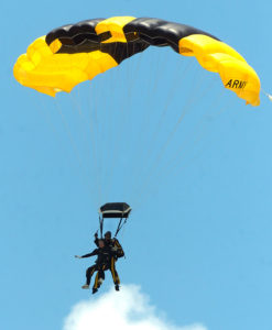 COLLEGE STATION, TX - JUNE 13: Former U.S. President George Bush (front), harnessed to U.S. Army Golden Knight Sgt. Bryan Schnell, glides to earth as he makes a tandem parachute jump to celebrate his 80th birthday June 13, 2004 in College Station, Texas. Bush planned to skydive alone, but officials decided high winds and low clouds made conditions too dangerous for him to take a solo jump. (Photo by Brett Coomer/Getty Images)