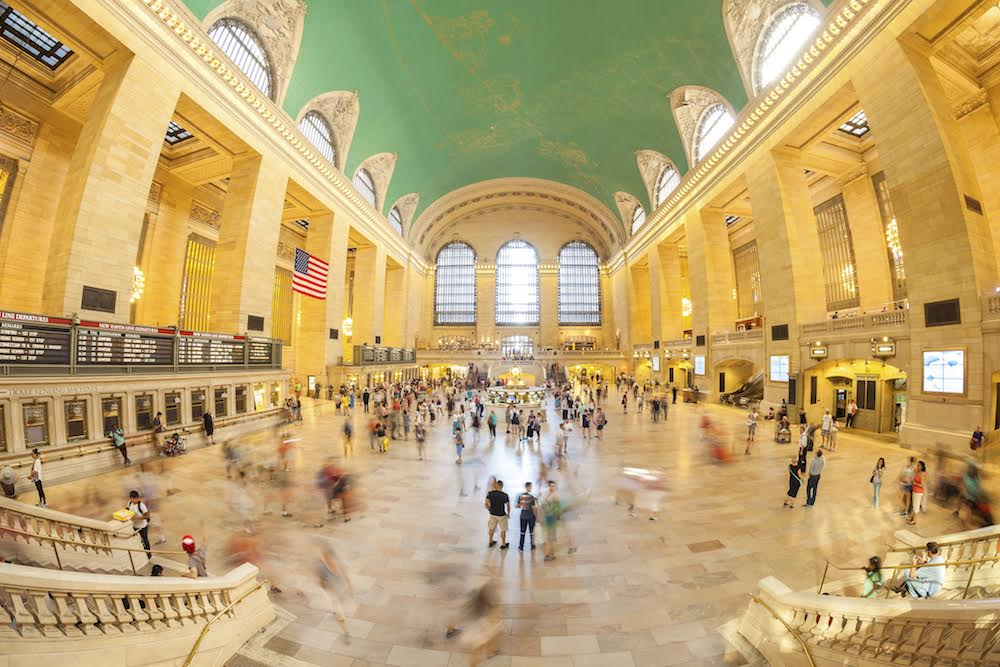 New York, USA - August 15, 2015: Fisheye lens picture of commuters in the Grand Central Terminal main hall during busy day.
