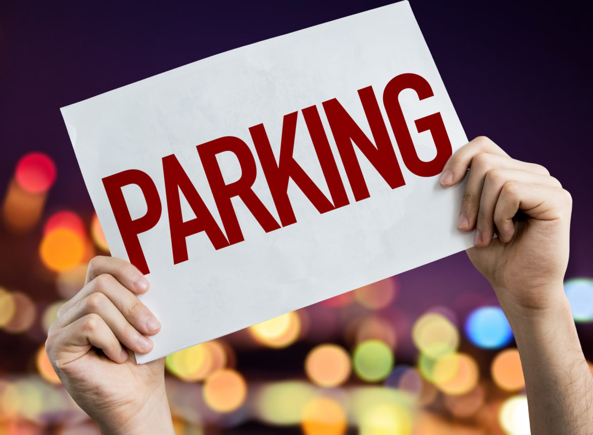 Parking placard with night lights on background