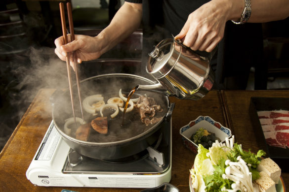 Owner and chef Mie Okuda makes beef sukiyaki at Momokawa restaurant in New York, July 11, 2014. (Samira Bouaou/Epoch Times)